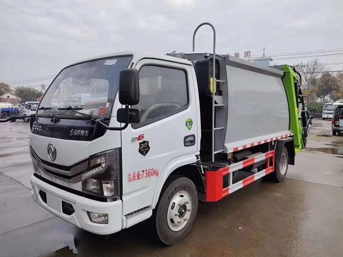 多功能东风多利卡D6压缩垃圾车,厢体容积6方