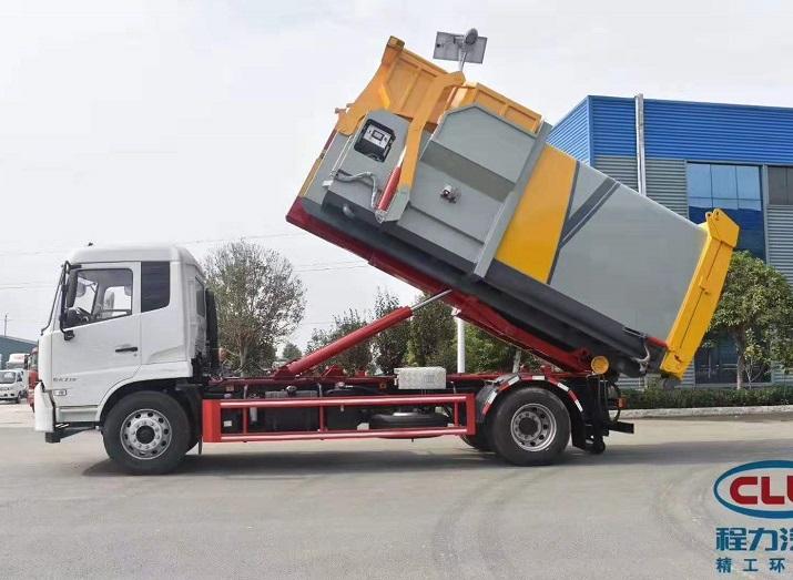 东风天锦勾臂垃圾车配12方智能移动压缩垃圾箱图片二