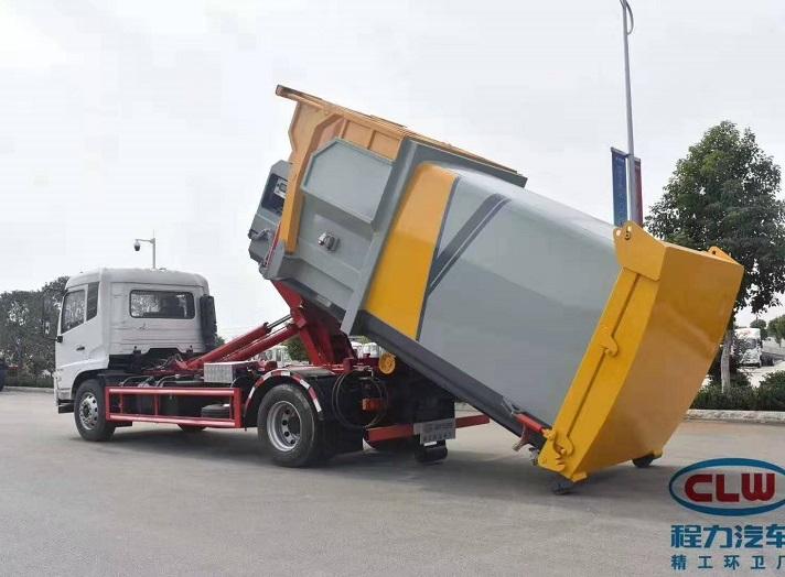 东风天锦勾臂垃圾车配12方智能移动压缩垃圾箱图片三
